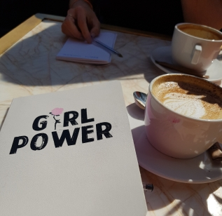 Girl power notepad and coffee at women co session